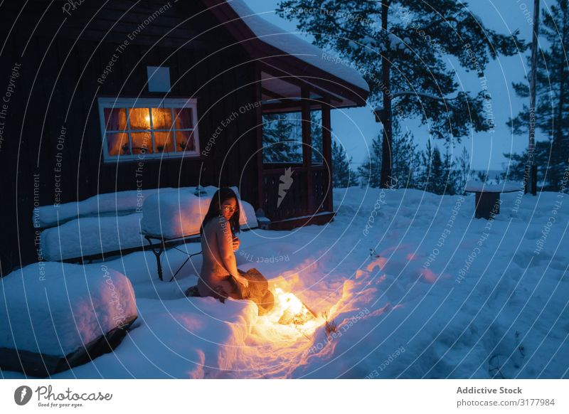 Naked woman sitting beside fire in snow Woman Snow Bonfire Mysterious Fire Twilight Purity Eroticism Tattooed Pensive White Charming Winter