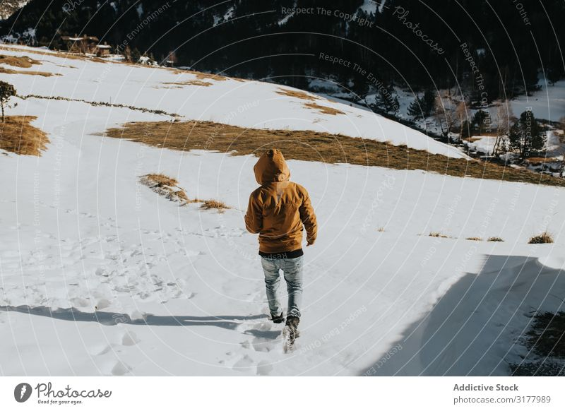 Man walking on footpath in snowy landscape Walking Car Hood Snow Footpath Mountain Landscape Slope Nature Action hiker Day Movement Winter Weather traveler