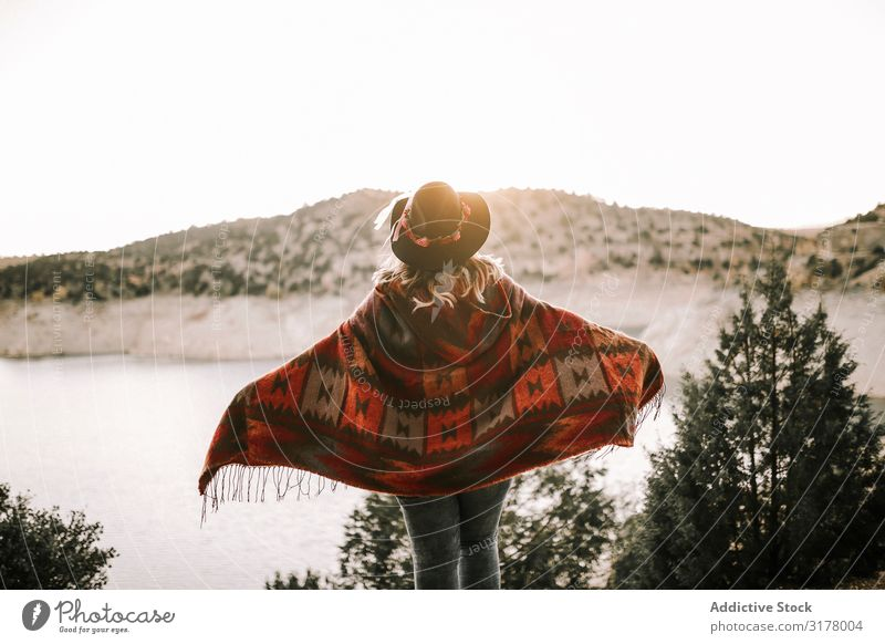 Anonymous woman near calm lake on sunrise Woman Lake Sunrise Sky Mountain Vacation & Travel admiring Morning Freedom Landscape poncho Hat Recklessness Dawn Dune