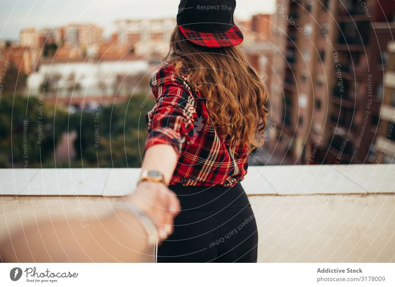 Unrecognizable female leading way on balcony Woman follow me City Balcony Hand Friendship Hip & trendy Lifestyle Leisure and hobbies Modern Town Terrace Style