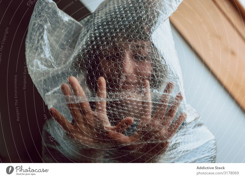Woman entangled in bubble wrap Plastic Reduce resources Bubble wrap Destruction Trash pollute Trash container Sustainability disposal Conceptual design