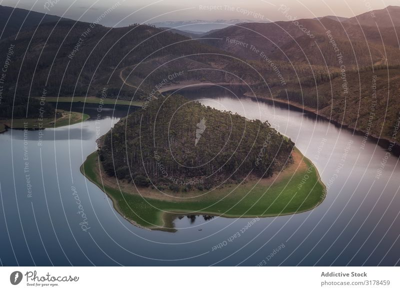 Small island on lake in mountain landscape Island Lake Mountain Wood Landscape drone view terrain loch Deserted Undulating Smooth Forest Surface Water