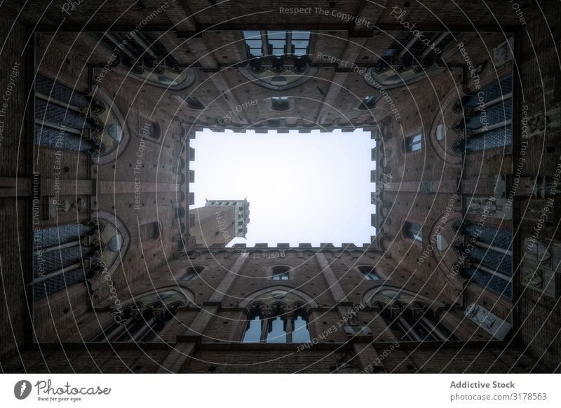Perspective view from courtyard on stone tower Courtyard Masonry Architecture Old Building Tuscany Italy medieval Stone Ancient Historic Castle
