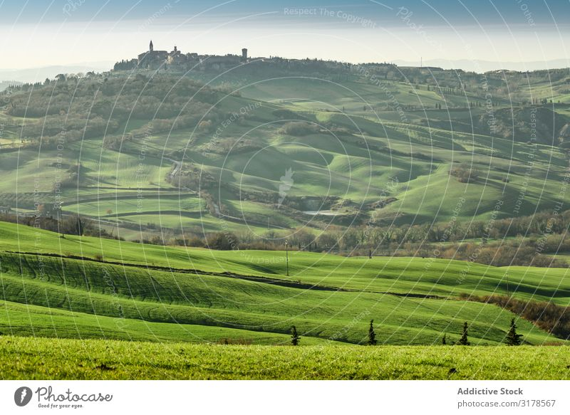 Majestic green valley with town on top Valley Highlands Town Tuscany Italy Rural Landscape Nature Beautiful Tourism Panorama (Format) Summer Mountain