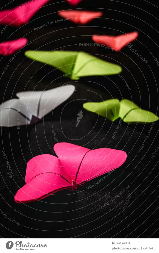 Multi-colored origami butterflies from above Lifestyle Style Design Beautiful Leisure and hobbies Playing Decoration Wallpaper Art Culture Butterfly Paper Toys