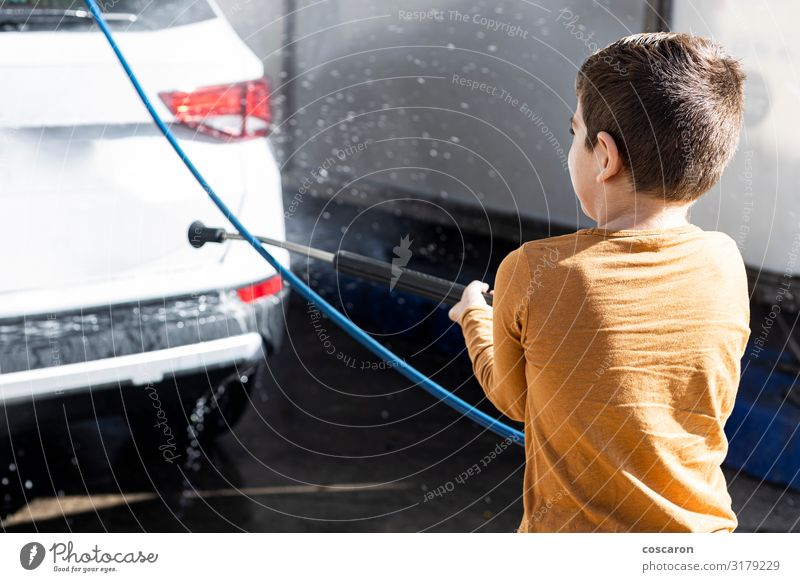 Little kid cleaning a car with a high pressure hose Woman Child Human being Summer Beautiful White Hand Joy Lifestyle Adults Funny Happy Boy (child) Business