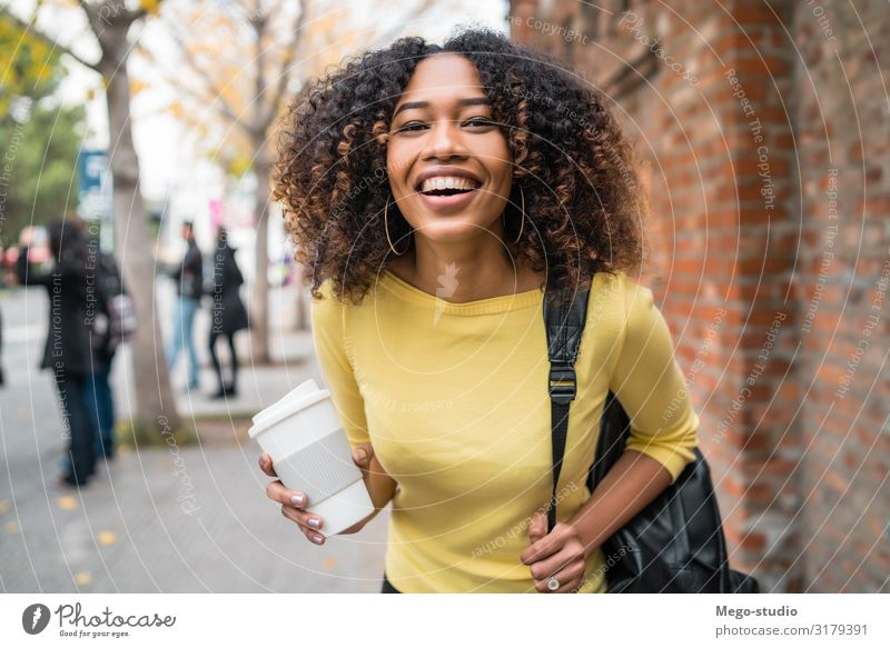 Afro-american woman walking on the street. Drinking Coffee Lifestyle Style Happy Beautiful Academic studies Human being Woman Adults Town Street Fashion