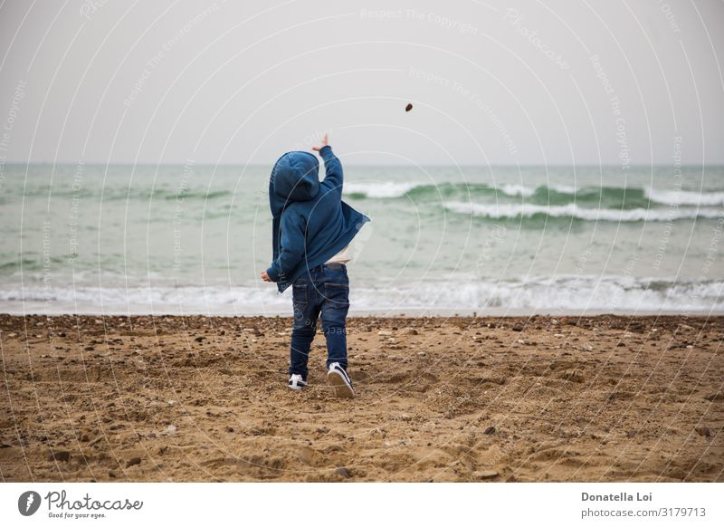 Child throws a stone in the sea Life Playing Beach Ocean Waves Winter Human being Masculine Infancy Body 1 1 - 3 years Toddler Autumn Jeans Stone Sand Blue