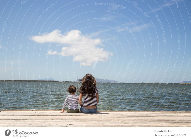 Brother and sister on pier Woman Child Human being Sky Vacation & Travel Nature Summer Water Ocean Clouds Adults Wood Feminine Couple Copy Space Freedom