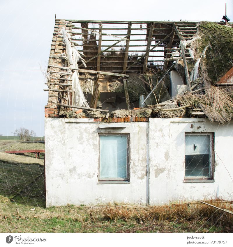 Roof damage in the holiday home Recreation area lost places GDR Sky Winter Beautiful weather Meadow Rügen Architecture Thatched roof house Window Wooden roof