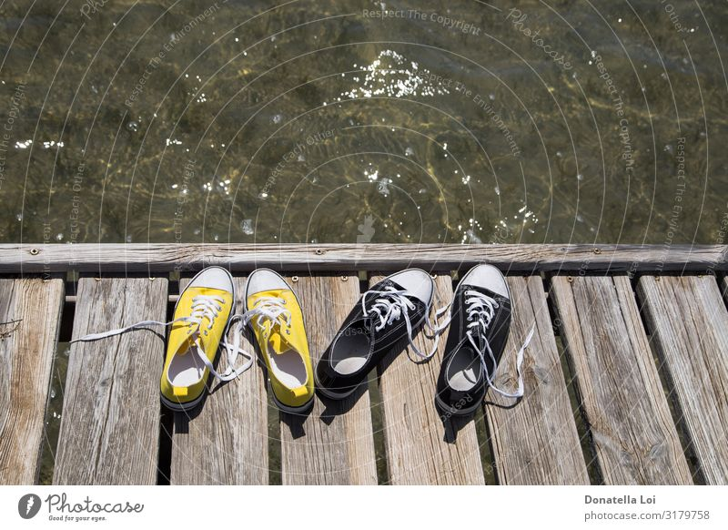Two pair of shoes on pier Lifestyle Calm Leisure and hobbies Vacation & Travel Trip Freedom Summer Summer vacation Ocean Waves Sports Lake Footwear Sneakers