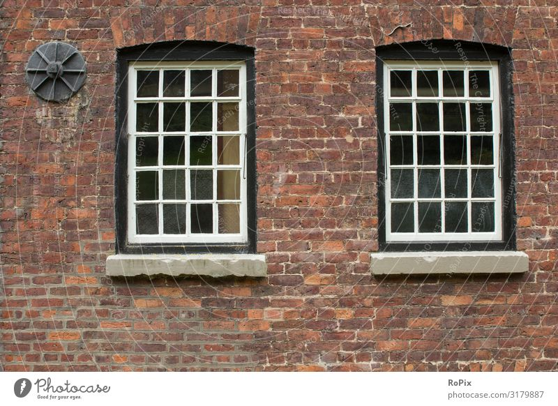 Old sash bar windows on a factory building. Wall (barrier) Grating Wall (building) rampart Depot Granite Ruin Sandstone Architecture country Country life