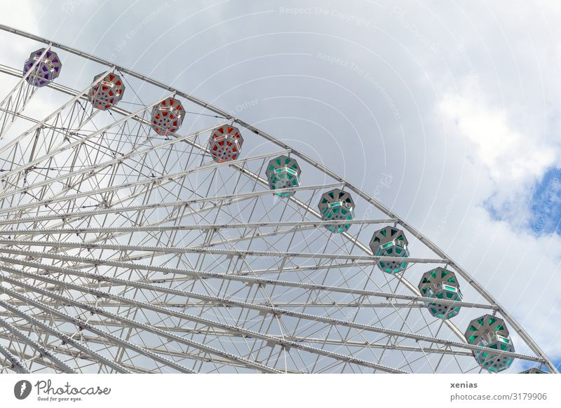 Detail of a still standing Ferris wheel with clouds Tourism City trip Summer Feasts & Celebrations Fairs & Carnivals Sky Clouds Manmade structures Rotate