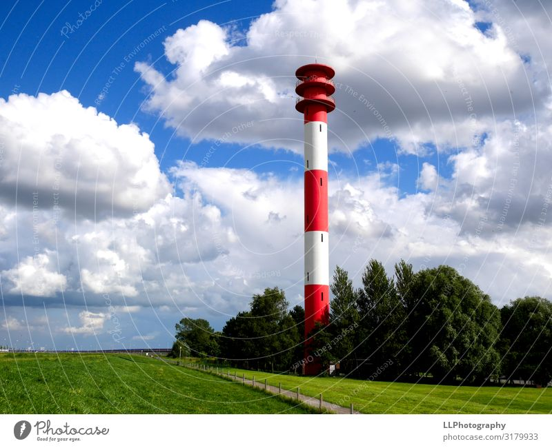 Beaming lighthouse Aquatics Sailing Landscape Clouds Gale Coast North Sea Port City Illuminate Dream Blue Red White Jadebusen Colour photo Exterior shot