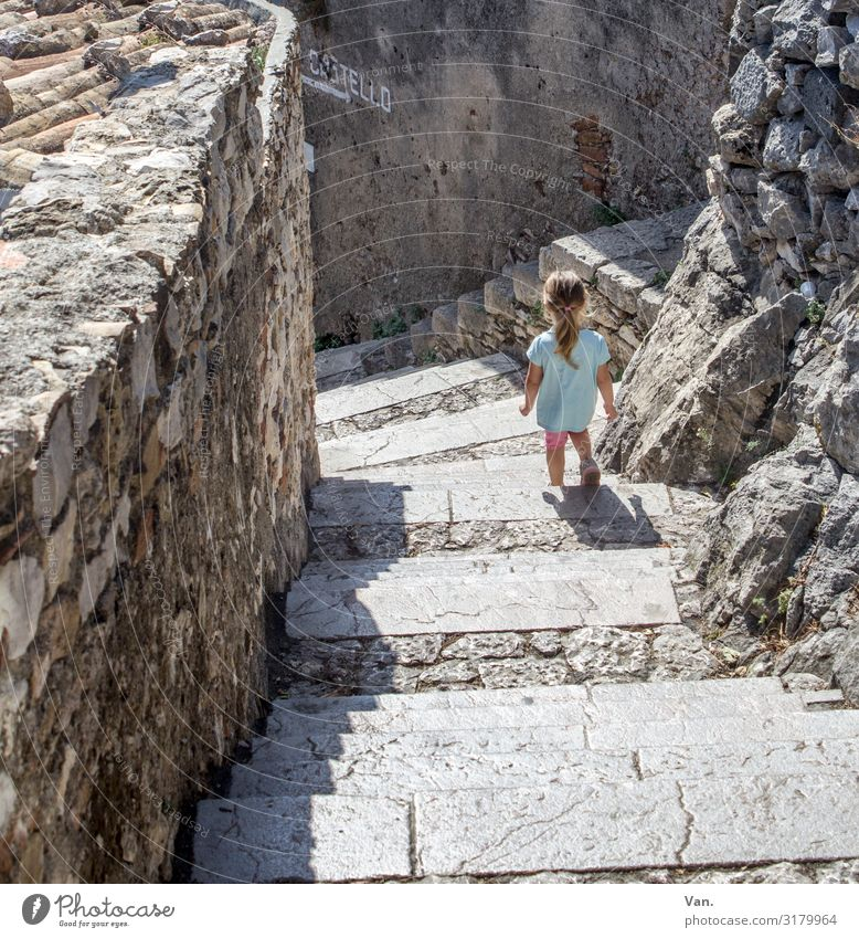 Human being Girl Wall (building) Small Wall (barrier) Stone Gray Going Hiking Stairs Italy Village Turquoise Toddler Sicily 1 - 3 years
