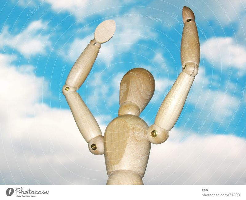 The articulated puppet is happy Manikin Clouds White Brown Wood Obscure Sky Blue Joy Arm