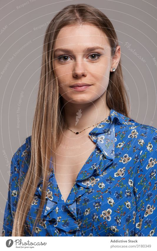 Blonde girl with floral shirt posing in studio Woman Youth (Young adults) Shirt Easygoing Model long hair Portrait photograph Modern Clothing outfit Calm