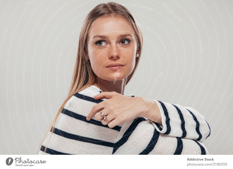 Pretty young woman in striped clothing Woman Youth (Young adults) Style Easygoing Striped Sweater Model long hair Portrait photograph Modern Clothing outfit