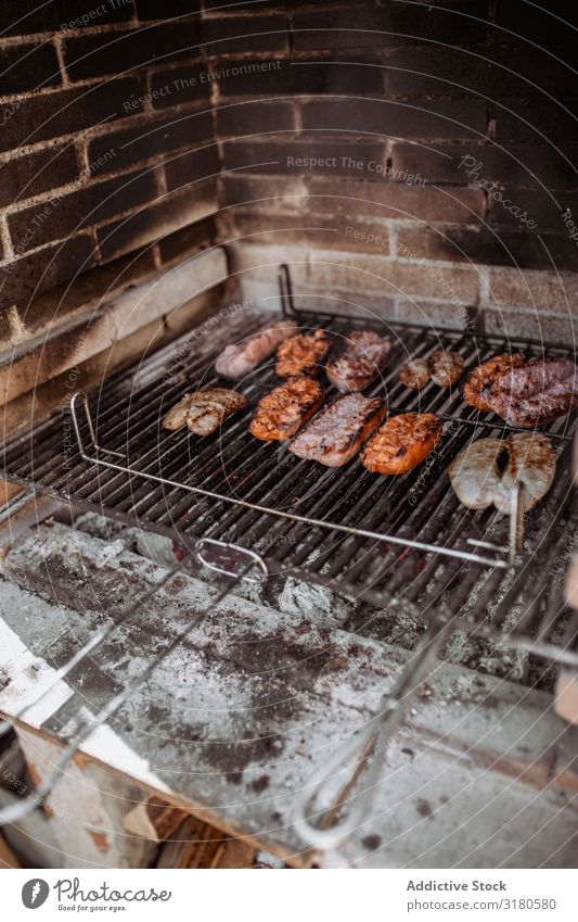 cooking sausages and chorizo in barbecue Eating Food Lunch Course (flight) burning Roasted Grill Smoke sirloin grilling Sliced barbecued Delicious Portion