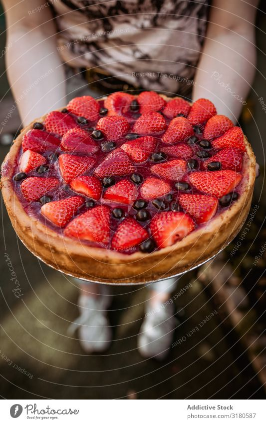 unrecognizable woman holding a delicious strawberry pie Birthday Food Fruit Confectionary Sugar Plate Stand Hand Day Party Strawberry Lady dotted Snack romantic