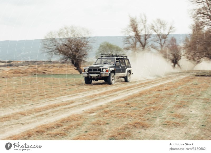 Off road riding in countryside Offroad Landscape Street Dust Tree Leafless Nature Ride Vacation & Travel Car Transport Adventure Vehicle 4x4 Trip Dry terrain