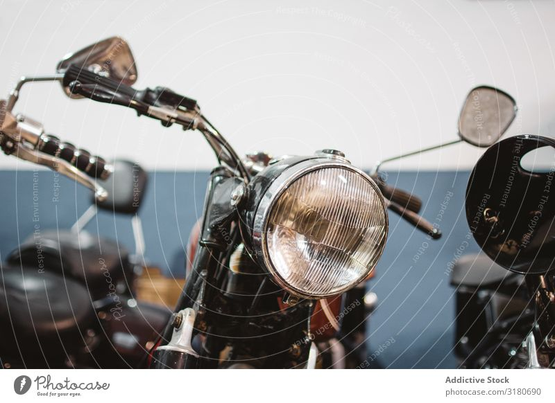 Retro motorcycles in garage Motorcycle Garage Repair headlights Broken Parked Service Workshop Mechanic Transport Equipment Vehicle Vintage Shabby Weathered