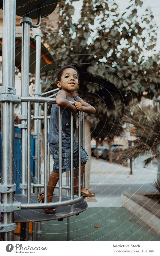 Funny black boy on playground Boy (child) Playground Park Black Grating Child Small Cute Playing Lifestyle Leisure and hobbies Rest Relaxation Entertainment