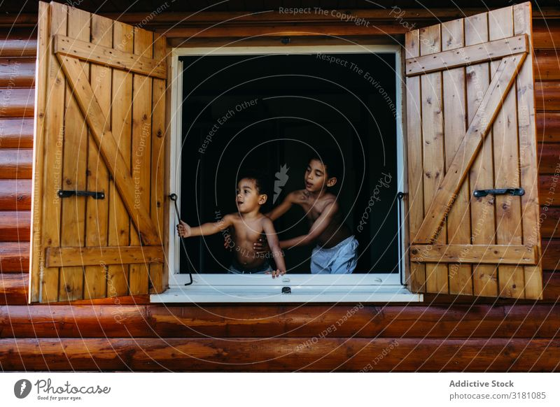 Black boys looking out window Window House (Residential Structure) Wood Open Joy Together African-American Child