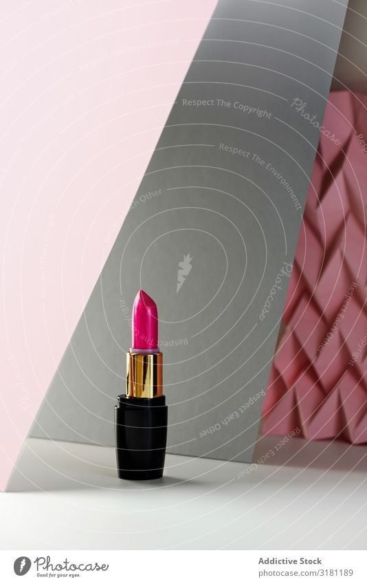 Lipstick on raised pink chevron. Product and make up concept Make-up Cosmetics Beauty Photography Background picture Pink Deserted Fashion Still Life Stick