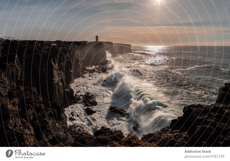 Landscape of lighthouse in Iceland Beacon Lighthouse Svörtuloft seaside Ocean Tower Coast Navigation Landmark Nautical Maritime Signal searchlight