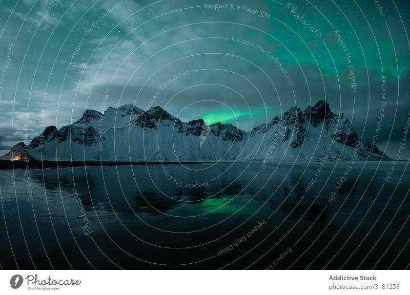 Snowy mountains covering with the fog Hill borealis northern Light Fog Covering stockness Vacation & Travel Tourism Nature Iceland Landscape Beautiful Natural
