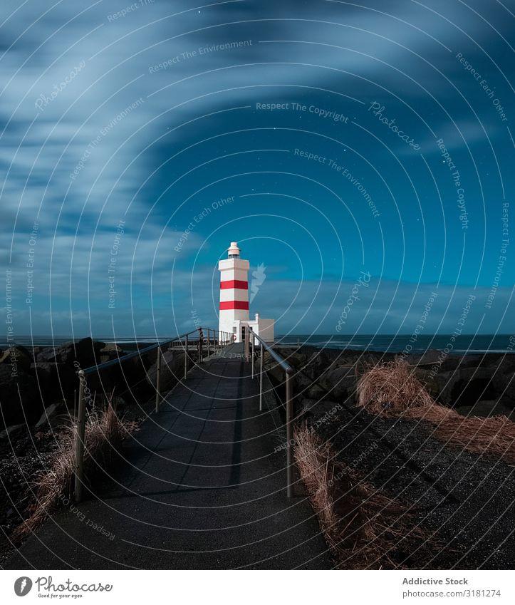 Lighthouse in Iceland Garður Sky Ocean White Nature Blue Water Landscape Tourism Coast Atlantic Ocean Vacation & Travel icelandic Europe Clouds