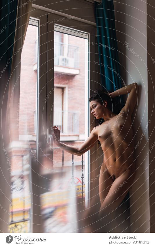 Naked woman standing near window Woman looking out Window Eroticism Youth (Young adults) Thin Flexible To enjoy Alluring Lean Provocative Home Hot Natural