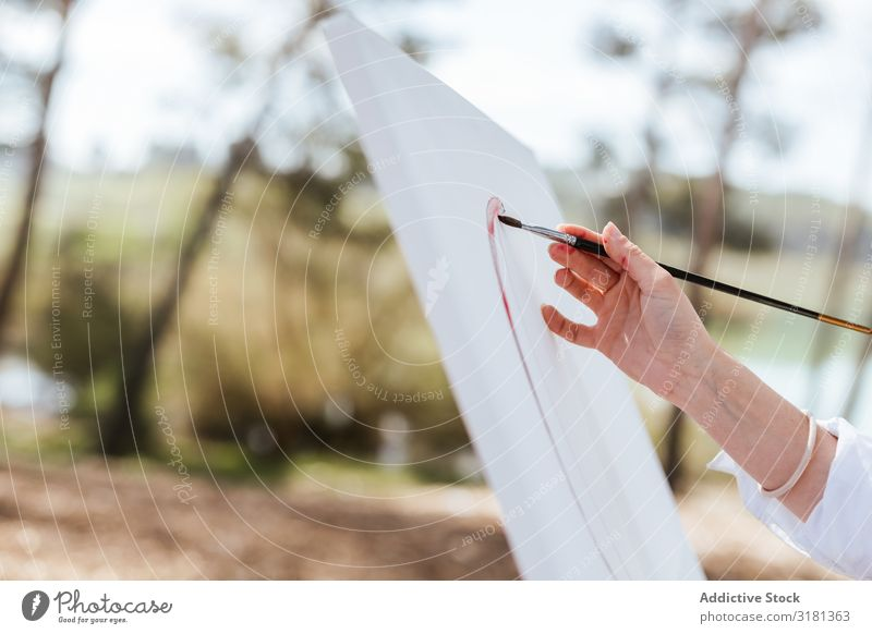 Crop hand painting on easel Artist Hand Nature Paintbrush Canvas Painting and drawing (object) Woman Easel