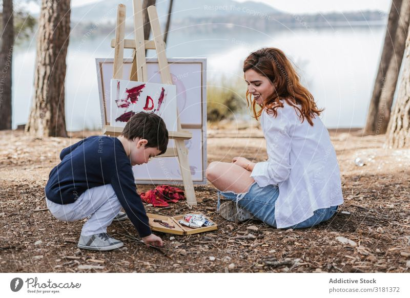 Mother and boy painting near lake Son Painting and drawing (object) Lake Nature Leisure and hobbies Lifestyle Together