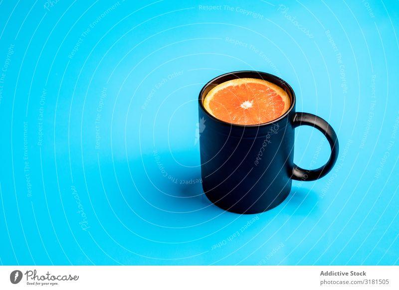 Mug with fresh citrus Breakfast Conceptual design Drinking Slice Morning Juicy Cut Grapefruit Orange Piece Fresh Raw Mature Vegan diet Energy Healthy Fruit