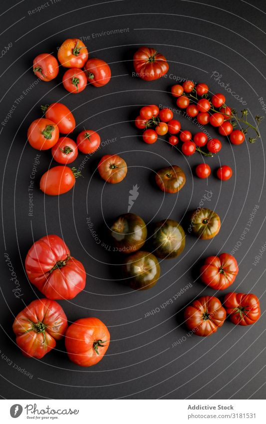from above view of tomatoes on a black surface Background picture Plant Vegetable Deserted Fresh Juicy Agriculture Fruit Food Healthy Black Tomato