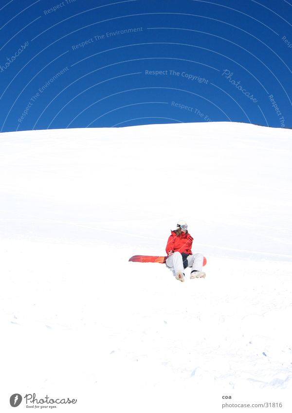 rest Winter White Red Snowboard Break Calm Crouch Sports Blue Sky Sit Snowboarder Cloudless sky Bright Colours Beautiful weather 1 Winter mood Ski run Flashy