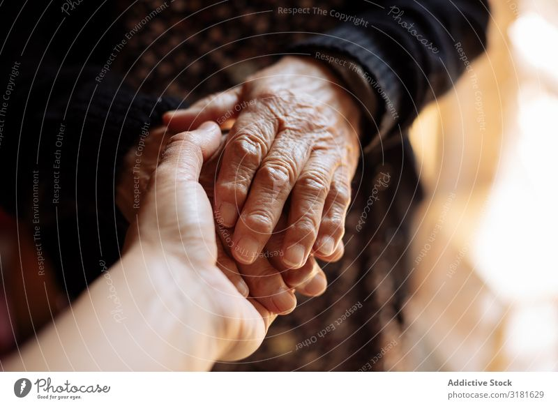 Man holding an elderly woman's hand Old Hand Hold Senior citizen Youth (Young adults) Grandchildren Grandmother Support Considerate Woman Doctor Love Patient