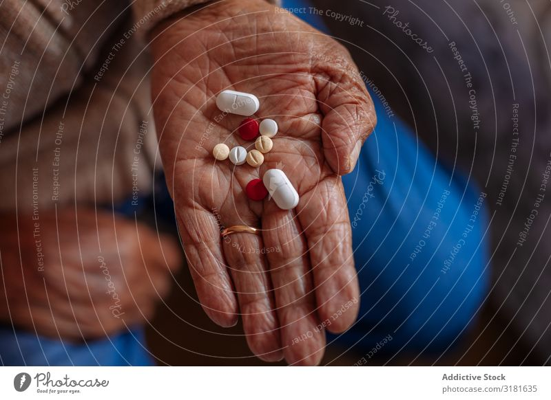 Detail of pills on the hand of an old man Hand Old Considerate Senior citizen Pill Man Human being Year date Caucasian Hold Intoxicant Adults Healthy Medication