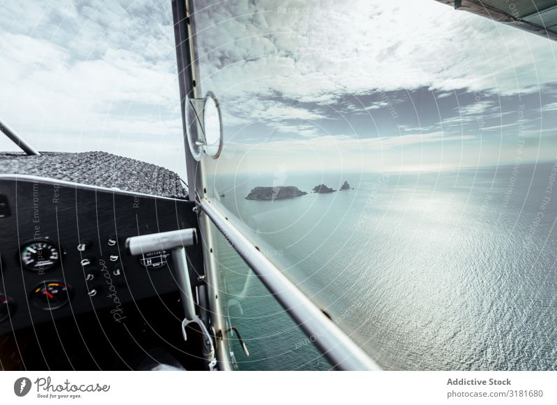 Flight over islands in the middle of the sea Airplane Aircraft Vantage point Window Summer Island Ocean Nature Blue Sky Vacation & Travel Landscape Horizon Fly
