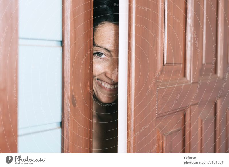 Smiling woman looking between open door and wall Woman Human being Youth (Young adults) Young woman Lifestyle Adults Feminine Emotions Fashion Elegant Stand