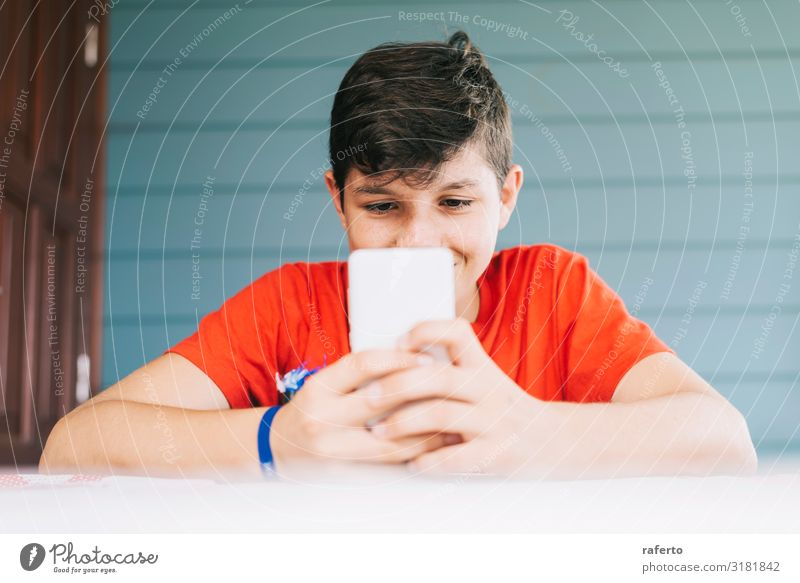 boy wearing red t-shirt sitting outdoors using phone Lifestyle Happy Leisure and hobbies Telephone Cellphone PDA Technology Human being Masculine Boy (child)