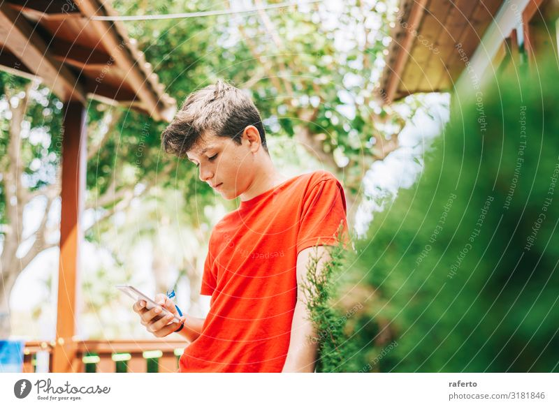 Profile of a happy male teen texting on a smart phone Child Human being Youth (Young adults) Man White Red Hand Adults Happy Boy (child) Masculine 13 - 18 years