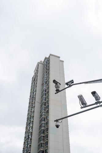 I spy -I- Video camera Surveillance camera Shanghai China High-rise Observe Town Gray Prompt Conscientiously Honest Concern Fear Nerviness Mistrust Aggression