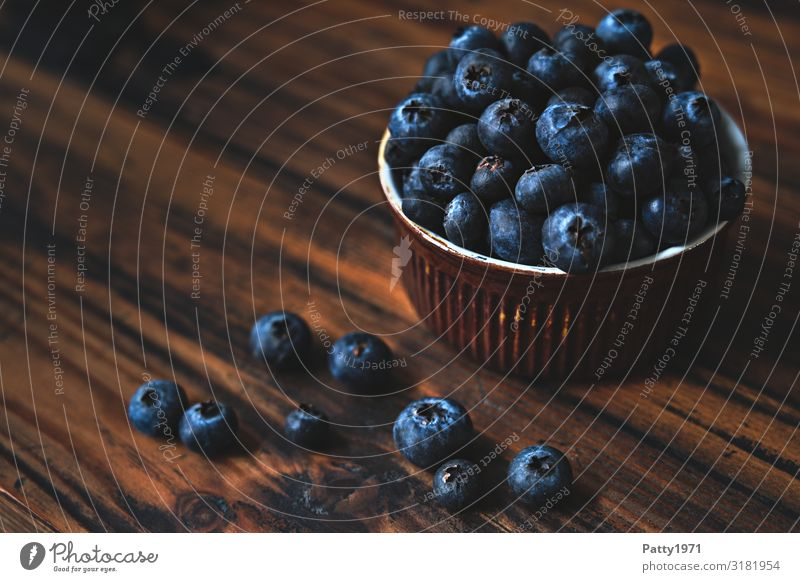 Blueberries in a bowl on a wooden base Food Fruit Blueberry Nutrition Organic produce Vegetarian diet Diet Bowl Fresh Delicious Round Juicy Sweet Brown To enjoy