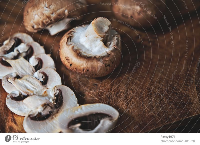 Mushrooms on a wooden table Food Button mushroom Nutrition Organic produce Vegetarian diet Chopping board Fresh Delicious Brown White To enjoy Food photograph