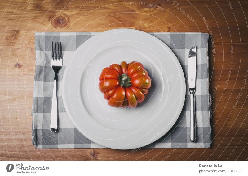 Red tomato on white plat Vegetable Nutrition Eating Lunch Dinner Diet Plate Fork Table Kitchen Nature Wood Feeding Authentic Good White Italy dietary knife one