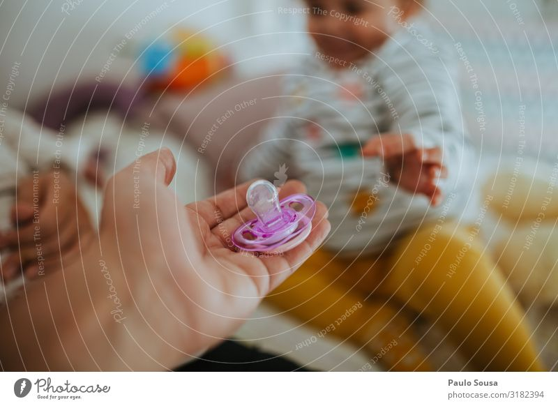 Father giving pacifier to child Lifestyle Human being Baby Toddler Girl Adults Hand 1 - 3 years Catch Love Lie Simple Happiness Together Curiosity Cute Original