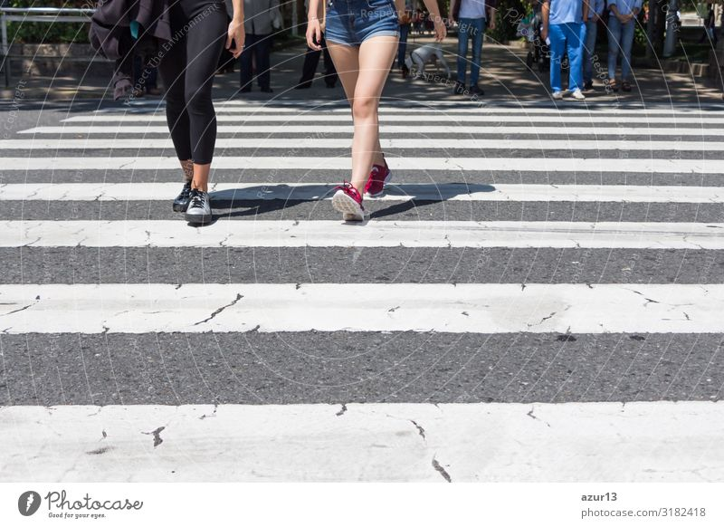 Pedestrian crossing city downtown women walk in motion on road Lifestyle Shopping Human being Woman Adults Downtown Stripe Stress pedestrian crosswalk City